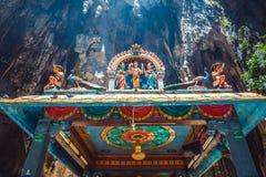 La statue d'hindouisme du temple chez Batu foudroie en Kuala Lumpur Photographie stock