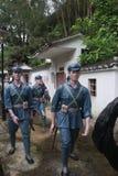 La statue du groupe d'A de troupes de l'armée rouges croisant le village dans le ¼ Œshenzhen, porcelaine de Parkï d'armée rouge Photographie stock