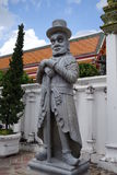 La statue en pierre chinoise d'un homme occidental en Wat Pho Photos libres de droits