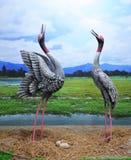 La statue tend le cou des oiseaux Photo stock