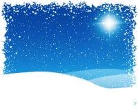 La stella di Bethlehem su una notte nevosa Fotografie Stock Libere da Diritti