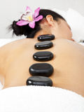 La stone massage. Young woman getting la stone massage Royalty Free Stock Photo