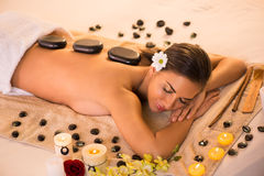 La-stone Therapy. Young beautiful woman relaxing and enjoying at La-stone Therapy Stock Image