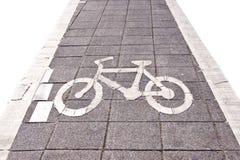 La strada della bicicletta canta sull'isolato bianco Fotografia Stock