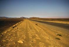 La strada nel deserto Immagini Stock