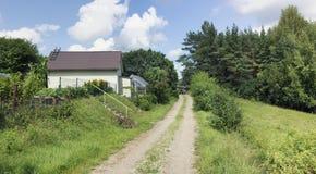 La strada non asfaltata rurale immagine stock