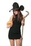 La strega piacevole con una scopa Fotografie Stock Libere da Diritti