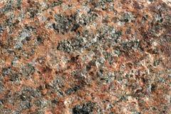 La structure du granit orange non moulu naturel avec les veines noires photographie stock