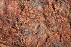 La structure du naturel n'est pas rouge poli de granit photo stock