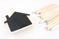 La struttura come casa con la matita di colore Immagini Stock
