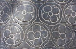 La struttura dei fiori ha intagliato in pietra grigia immagine stock libera da diritti