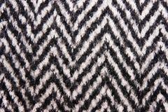 La struttura del cappotto in bianco e nero della lana Fotografia Stock