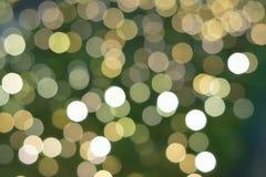 La struttura del fondo di verde ha colorato le luci vaghe decorazione di Natale Immagine Stock Libera da Diritti