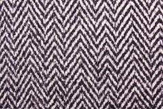 La struttura del tessuto in bianco e nero della lana Immagine Stock