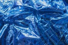 La struttura del tessuto sgualcito è colore blu metallico fotografia stock libera da diritti
