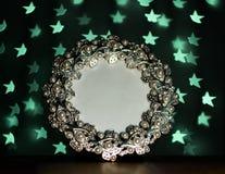 La struttura della foto con verde della sfuocatura stars su fondo nero Fotografia Stock