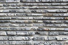 La struttura della pietra naturale ha allineato Fondo per i progettisti fotografie stock libere da diritti