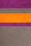 La struttura di cuoio arancione, marrone e viola ha cucito Immagine Stock Libera da Diritti