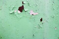 La struttura di due arrugginiti colora vecchio il metallo ossidato misero rossastro e verde, il ferro con la sbucciatura bulbted  immagine stock libera da diritti