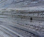 La struttura di incerata grigia con le bolle della pioggia Polietilene grigio, vista del primo piano immagini stock