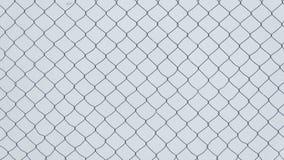 La struttura di un recinto del collegamento a catena su un fondo bianco Fotografia Stock Libera da Diritti