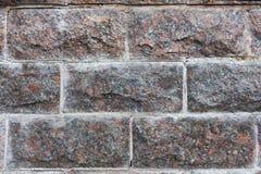 La struttura di una pietra del granito Fondo di pietra fotografia stock libera da diritti