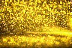 La struttura dorata Colorfull di scintillio ha offuscato il fondo astratto per il compleanno, l'anniversario, le nozze, la vigili Fotografie Stock