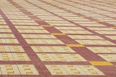 La struttura, fondo, area variopinta ha allineato con le lastre per pavimentazione Immagine Stock Libera da Diritti