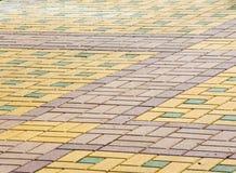 La struttura, fondo, area variopinta ha allineato con le lastre per pavimentazione Immagini Stock Libere da Diritti
