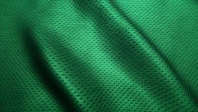 La struttura verde dei jeans di alta qualità del tessuto, muoventesi ondeggia Fotografia Stock Libera da Diritti