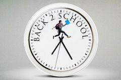La studentessa salta sull'orologio Fotografie Stock Libere da Diritti
