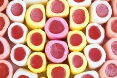 La sucrerie colorée colle le fond Photos stock
