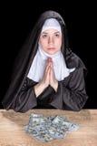 La suora chiede soldi Immagine Stock