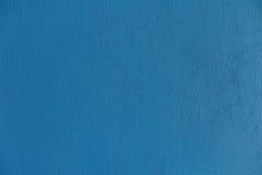 La superficie brillante de la pared azul pintada Foto de archivo