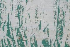 La superficie del ferro è coperta di resti di vecchia pittura, la struttura grigia, fondo Immagine Stock