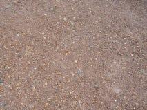 La superficie della ghiaia è marrone fotografia stock libera da diritti