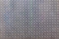 La superficie della lamina di metallo con il modello industriale come fondo immagine stock libera da diritti