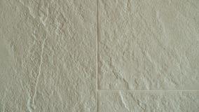 La superficie delle mattonelle di pietra ruvide, mura strutturato Immagine Stock