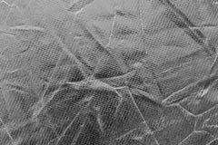 La superficie dello strato riflettente nero è sgualcita Immagini Stock Libere da Diritti