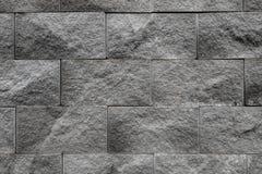 La superficie gris de la pared utiliza muchos ladrillos O viejo modelo negro del extracto de la pared de ladrillo imagenes de archivo