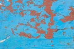 La surface de fer est couverte de vieille peinture, peinture ébréchée, fond de texture Images stock