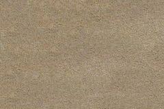 La surface de la plage sablonneuse Texture grenue photographie stock