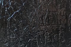 La surface métallique est peinte avec la peinture à l'huile noire photos stock