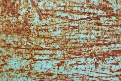 La surface métallique rayée avec les taches rouillées Image libre de droits