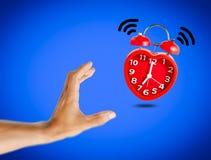 La sveglia rossa della campana sveglia all'orologio del ` di 7 o Immagine Stock