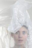 La tête de la fille dans un sachet en plastique Photographie stock