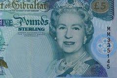La tête de la reine sur le billet de banque du Gibraltar photo stock
