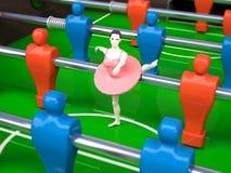 La tabla de Foosball con la muchacha del bailarín, hembra se divierte conceptos Imagenes de archivo