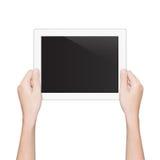 La tableta de la tenencia de la mano del primer aisló la trayectoria de recortes blanca dentro imágenes de archivo libres de regalías