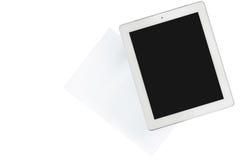 La tableta y el papel se aísla en transparente Imagen de archivo libre de regalías